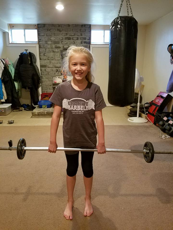 future strongwoman of Granite Barbell! Demonstrating the deadlift and overhead press, while proudly wearing her new t-shirt. Granite Barbell Orange County NY gym November 27, 2016